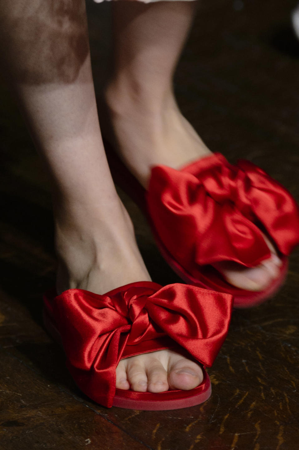 <p><i>Crimson satin bow slides from the SS18 Simone Rocha collection. (Photo: ImaxTree) </i></p>