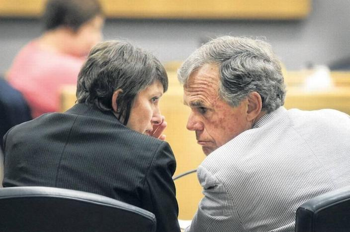 Gaston County District Attorney Locke Bell received Mark Carver's complete file from his former defense attorney in June, a new court document alleges. Legal experts say that's a potential violation of state law and legal ethics. Bell is shown in this photograph talking to Assistant District Attorney Stephanie Hamlin during an unrelated case. Hamlin helped convict Carver of murder in 2011.