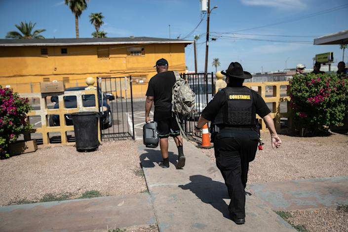 Maricopa County constable Darlene Martinez evicts a tenant on October 7, 2020 in Phoenix, Arizona. Thousands of court-ordered evictions continue nationwide despite a Centers for Disease Control (CDC) moratorium for renters impacted by the coronavirus pandemic. (John Moore/Getty Images)