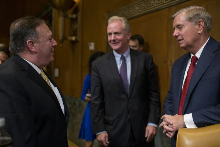 US Senators Chris Van Hollen (C) and Lindsey Graham (R) -- seen here speaking to Secretary of State Mike Pompeo  in June 2018 -- have proposed tough sanctions on Turkey over its offensive in Kurdish-controlled areas of northern Syria