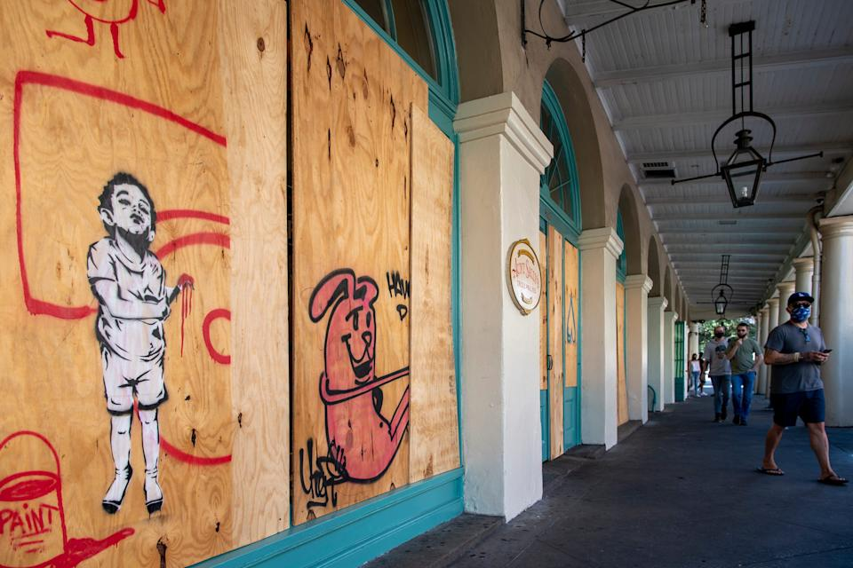 New Orleans' French Market is boarded up before Tropical Storm Marco.