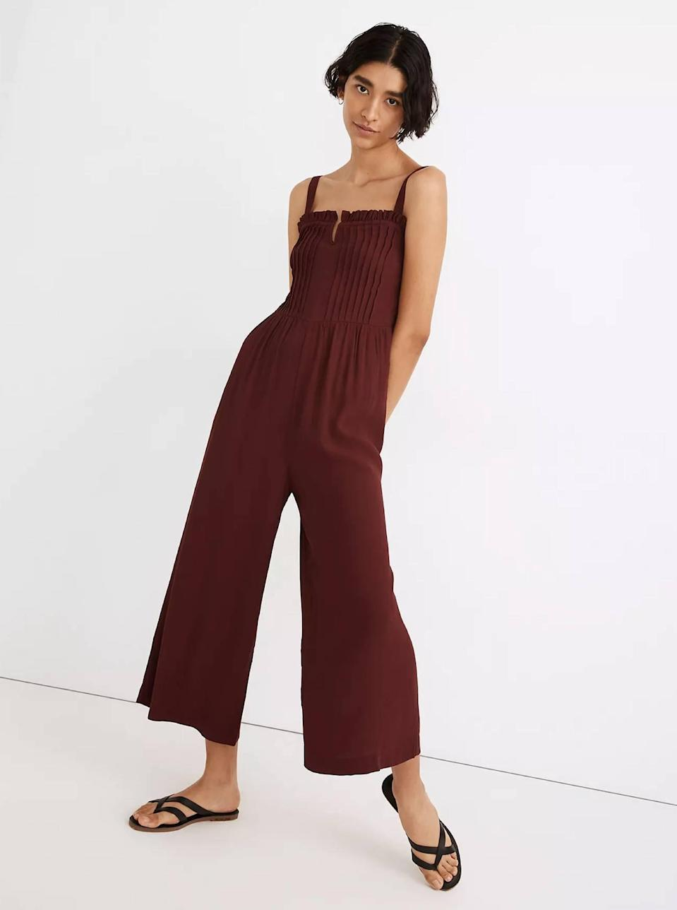 """There's no easier warm-weather outfit than a flowy jumper. Dress this one down with flat sandals or sneakers to run errands, or dress it up with heels and <a href=""""https://www.glamour.com/gallery/best-statement-earrings-under-50-dollars?mbid=synd_yahoo_rss"""" rel=""""nofollow noopener"""" target=""""_blank"""" data-ylk=""""slk:statement earrings"""" class=""""link rapid-noclick-resp"""">statement earrings</a>. $138, Madewell. <a href=""""https://www.madewell.com/pintuck-cami-jumpsuit-MA197.html?"""" rel=""""nofollow noopener"""" target=""""_blank"""" data-ylk=""""slk:Get it now!"""" class=""""link rapid-noclick-resp"""">Get it now!</a>"""