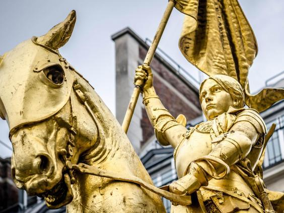 Joan of Arc, whose statue stands in Paris, led an army to victory dressed as a soldier during the Hundred Years War when women were not supposed to fight (Shutterstock)