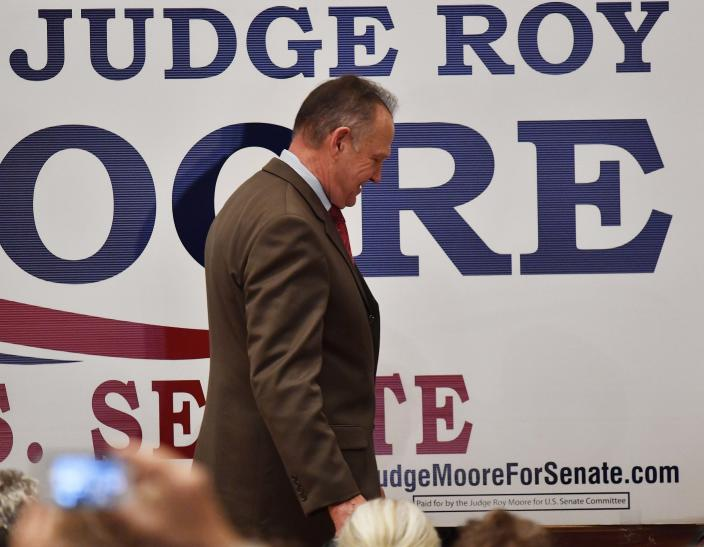Roy Moore leaves the stage after speaking in Montgomery, Ala., Dec. 12, 2017. (Photo: Mike Stewart/AP)