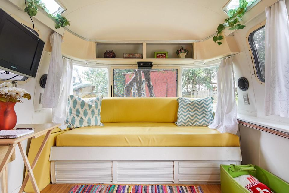 """<p>This bright, cheery Argosy Airstream is parked in the heart of <a href=""""https://www.cntraveler.com/destinations/austin?mbid=synd_yahoo_rss"""" rel=""""nofollow noopener"""" target=""""_blank"""" data-ylk=""""slk:South Austin"""" class=""""link rapid-noclick-resp"""">South Austin</a>, a short drive or walk from popular restaurants, bars, and coffee shops (we recommend the nearby <a href=""""https://summermooncoffee.com/"""" rel=""""nofollow noopener"""" target=""""_blank"""" data-ylk=""""slk:Summer Moon Coffee"""" class=""""link rapid-noclick-resp"""">Summer Moon Coffee</a>). Inside, there are plenty of retro touches, from the teal blue combo toaster oven-coffee maker to the cherry red Nostalgia Electrica mini fridge (there's a full oven and sink in the kitchen, too). It's best suited for a couple, with one double bed tucked into the bedroom area, though there is a sofa bed if you'd like to fit a third guest in. There are two shower options: a camper shower indoors, and a roomier outdoor shower.</p> <p><strong>Book now:</strong> <a href=""""https://airbnb.pvxt.net/G7J72"""" rel=""""nofollow noopener"""" target=""""_blank"""" data-ylk=""""slk:From $95 per night, airbnb.com"""" class=""""link rapid-noclick-resp"""">From $95 per night, airbnb.com</a></p>"""