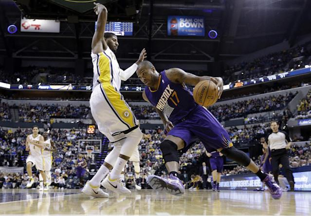 Phoenix Suns forward P.J. Tucker, right, drives against Indiana Pacers forward Paul George in the first half of an NBA basketball game in Indianapolis, Thursday, Jan. 30, 2014. (AP Photo)