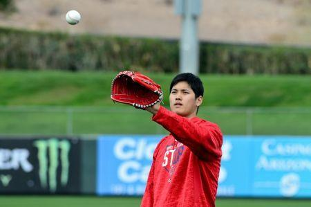Feb 13, 2018; Tempe, AZ, USA; Los Angeles Angels pitcher Shohei Ohtani plays catch during a workout at Tempe Diablo Stadium. Mandatory Credit: Matt Kartozian-USA TODAY Sports