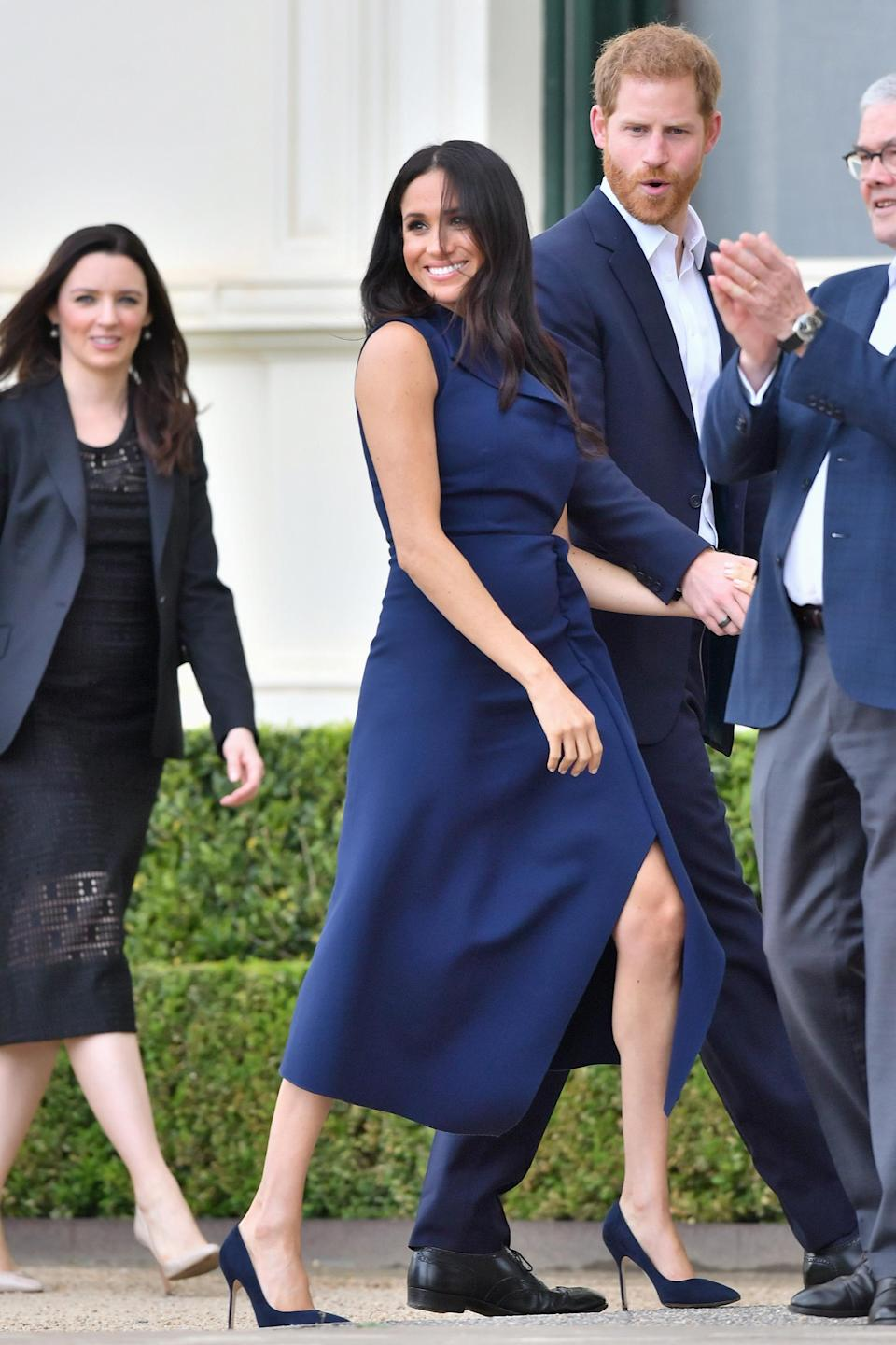"""<p>She paired the dress with navy <a rel=""""nofollow noopener"""" href=""""https://www.manoloblahnik.com/au/shopping/bb-12237005"""" target=""""_blank"""" data-ylk=""""slk:Manolo Blahnik BB heels"""" class=""""link rapid-noclick-resp"""">Manolo Blahnik BB heels</a> she's worn before, and the trench coat by Paris-based Aussie designer Martin Grant which she also pulled out on Tuesday. Photo: Getty </p>"""