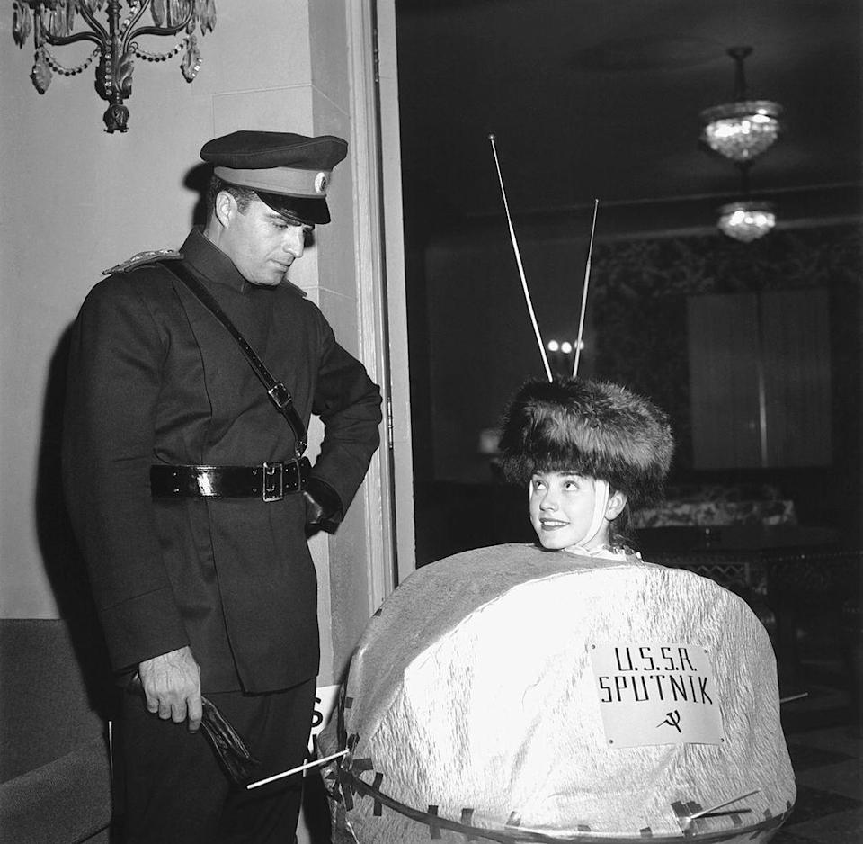 """<p>Since Sputnik launched October 4, 1957, it's no surprise that party-goers got creative by donning Sputnik-inspired costumes just weeks later. Here, a """"Sputnik"""" and a soviet officer attend a Halloween party in California.</p>"""