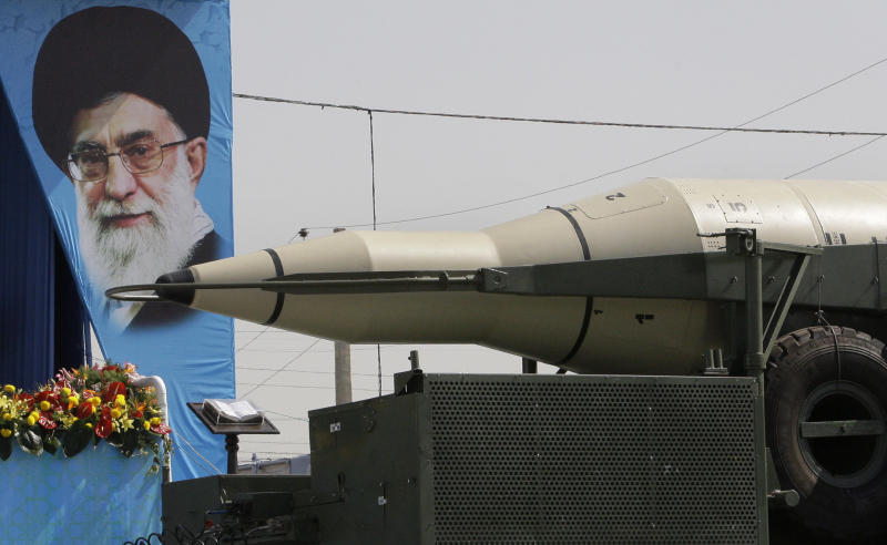 A Sajjil missile is displayed by Iran's Revolutionary Guard, in front of a portrait of the Iranian supreme leader Ayatollah Ali Khamenei, during a military parade commemorating the start of the Iraq-Iran war 32 years ago, in front of the mausoleum of the late revolutionary leader Ayatollah Khomeini, just outside Tehran, Iran, Friday, Sept. 21, 2012. (AP Photo/Vahid Salemi)