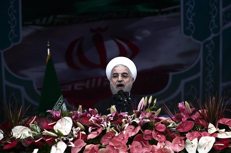Iranian President Hassan Rouhani delivers a speech in Tehran's Azadi Square (Freedom Square) to mark the 36th anniversary of the Islamic revolution on February 11, 2015 (AFP Photo/Behrouz Mehri)