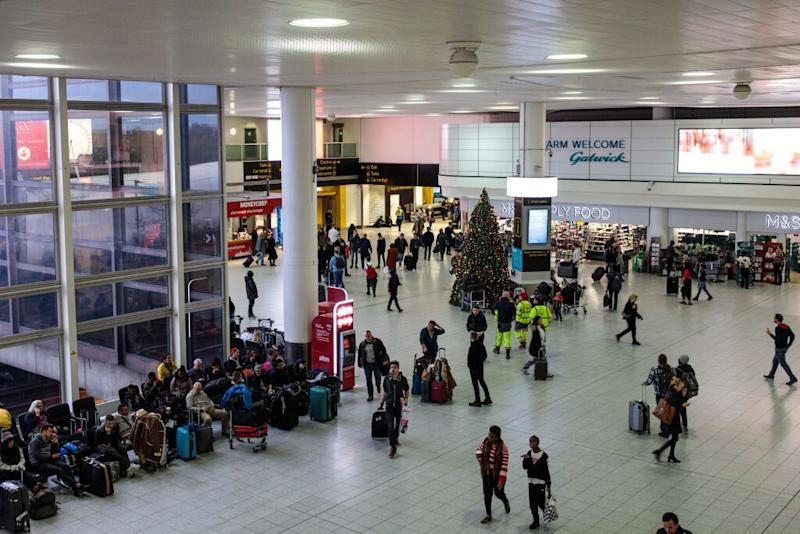 The passenger reportedly fell from a height in front of other shocked passengers (Stock Photo: Getty Images)