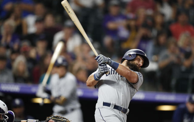 San Diego Padres' Nick Martini watches his RBI triple off Colorado Rockies starting pitcher Peter Lambert during the fifth inning of a baseball game Saturday, Sept. 14, 2019, in Denver. (AP Photo/David Zalubowski)