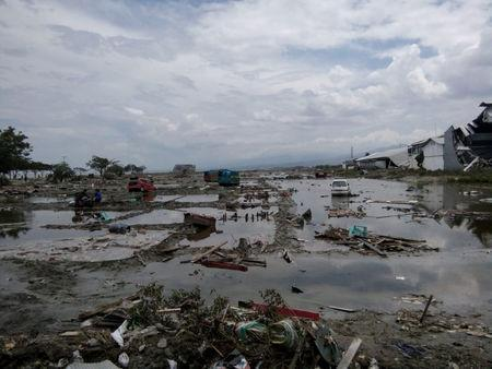 The ruins of cars as seen after tsunami hit in Palu, Indonesia September 29, 2018. REUTERS/Stringer