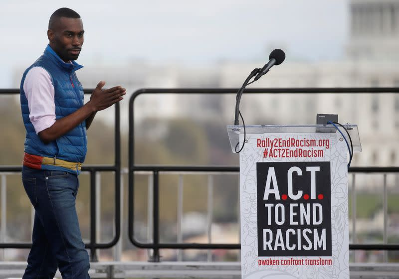 """FILE PHOTO: Civil rights activist DeRay Mckesson arrives to speak at the """"End Racism Rally"""" on the National Mall on the 50th anniversary of the assassination of civil rights leader Rev. Martin Luther King Jr. in Washington"""