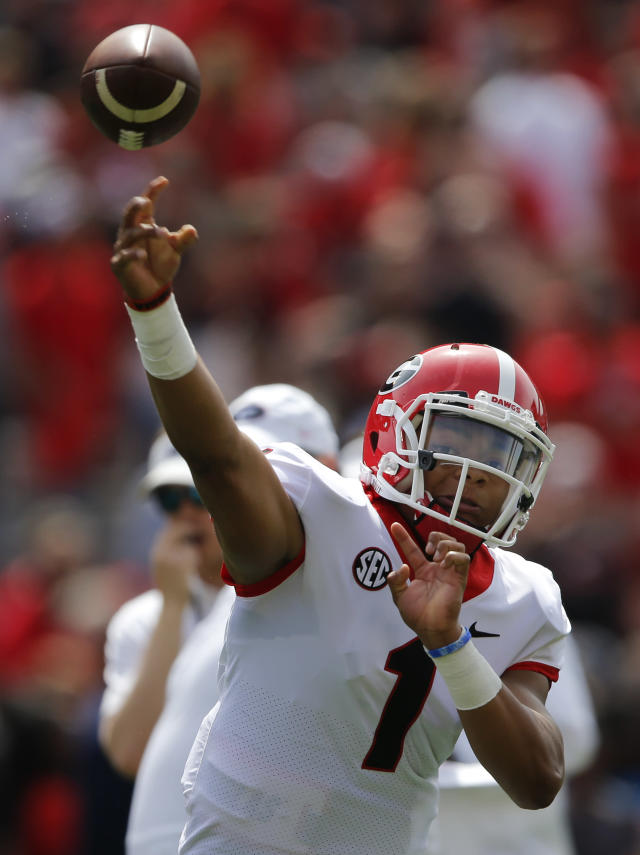 Georgia quarterback Justin Fields warms up before the start of the annual G Day intrasquad spring college football game Saturday, April 21, 2018, in Athens, Ga. (AP Photo/John Bazemore)