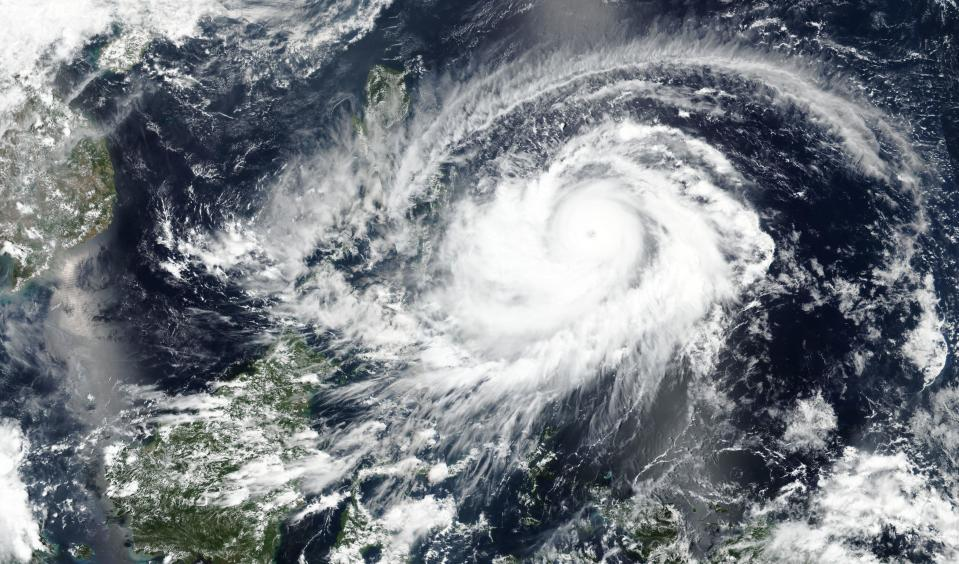 This April, 17, 2021 satellite image released NASA shows typhoon Surigae approaching Philippines. The approaching typhoon has prompted the evacuation of more than 100,000 people as a precaution in the Philippines, although the unusual summer storm is not expected to blow into land. (NASA Worldview, Earth Observing System Data and Information System (EOSDIS) via AP)