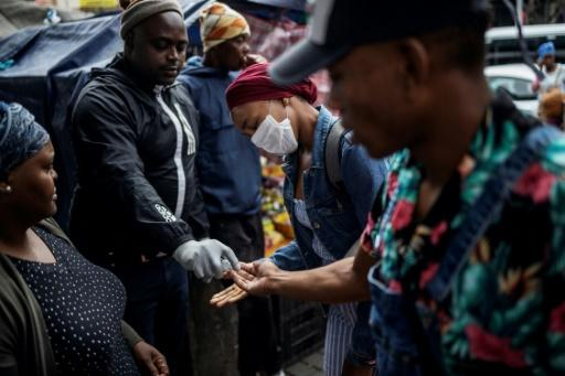 Hand hygiene at a taxi rank in Johannesburg: The government has been urging the public to brake the feared surge in coronavirus cases with simple prevention