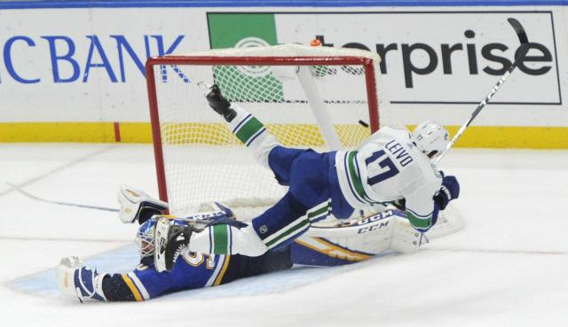 Canucks down Blues in shootout, get 1st road win