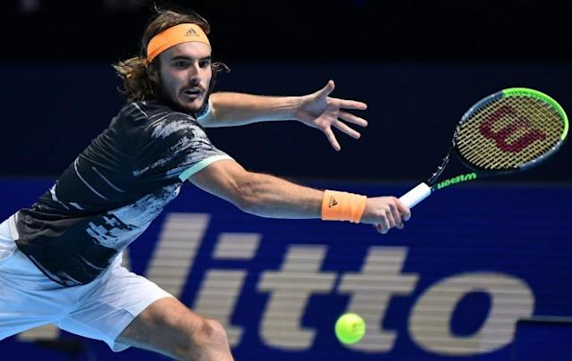Stefanos Tsitsipas in action against Dominic Thiem in the final of the 2019 ATP Finals (AFP Photo/Glyn KIRK )