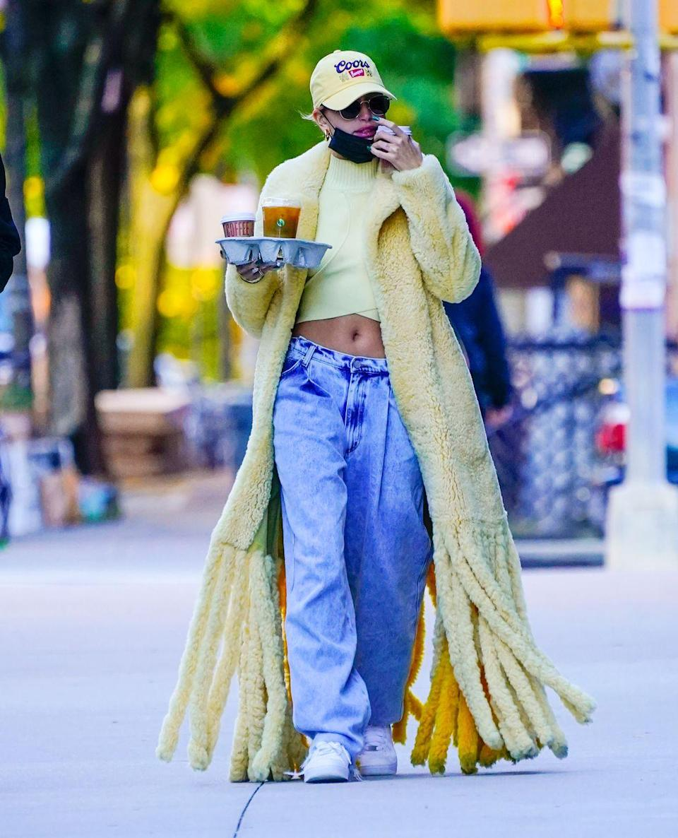 "<p>Hailey did a coffee run in New York in that Bottega Veneta teddy shearling yellow coat (which looks as practical for the weather as it is on trend), matching cap, baggy jeans and sneakers.</p><p><a class=""link rapid-noclick-resp"" href=""https://go.redirectingat.com?id=127X1599956&url=https%3A%2F%2Fwww.farfetch.com%2Fuk%2Fshopping%2Fwomen%2Fbottega-veneta-teddy-shearling-coat-item-15490284.aspx&sref=https%3A%2F%2Fwww.elle.com%2Fuk%2Ffashion%2Fcelebrity-style%2Farticles%2Fg31247%2Fhailey-baldwin-fashion-style-file%2F"" rel=""nofollow noopener"" target=""_blank"" data-ylk=""slk:SHOP NOW"">SHOP NOW</a> Bottega Veneta teddy shearling coat</p>"