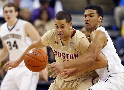 Wake Forest's Devin Thomas, right, knocks the ball from Boston College's Ryan Anderson, left, during the first half of an NCAA college basketball game in Winston-Salem, N.C., Saturday, Jan. 12, 2013. (AP Photo/Chuck Burton)