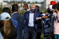 Erin O'Toole, leader of Canada's Conservative Party, elbow bumps supporters at a rally in his home electoral district of Dundas in the final week of campaigning ahead of the snap election (AFP/Cole Burston)