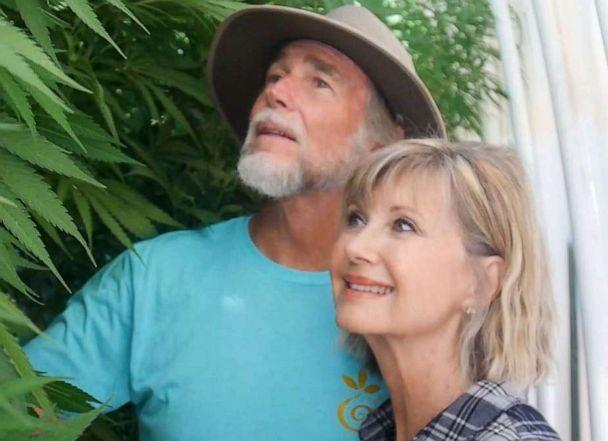 PHOTO: Olivia Newton-John is photographed with her husband John Easterling in their cannabis greenhouse at their California home. (ONJ Foundation)