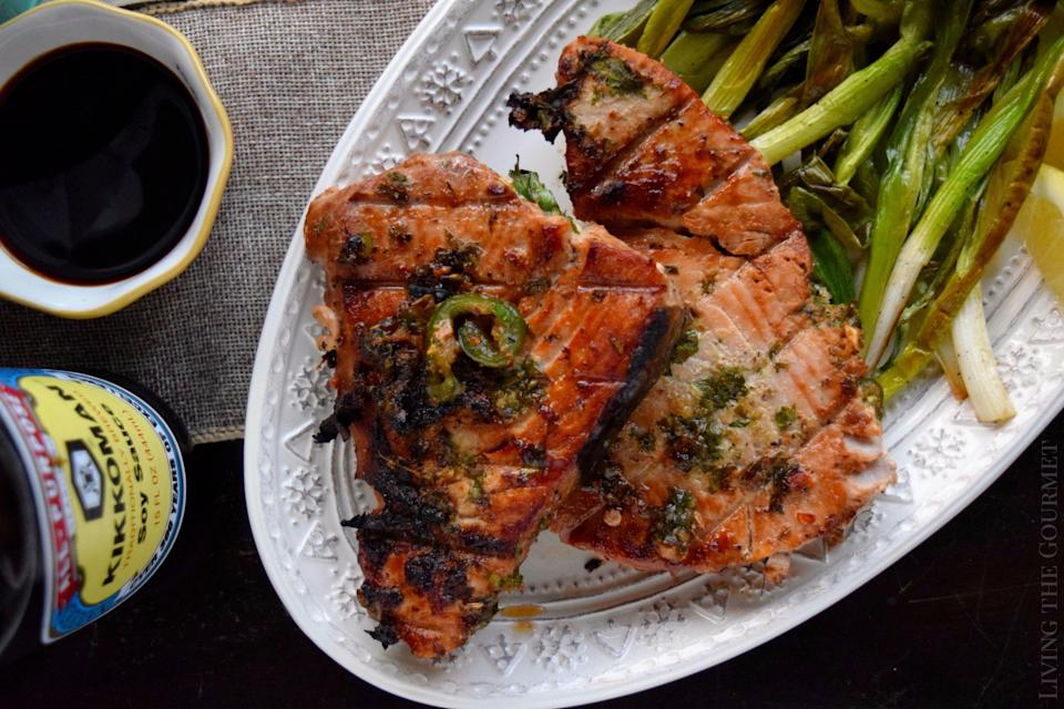 """<p>Grilled tuna marinated in a mixture of soy sauce, ginger, garlic and jalapeno is deeply flavorful and full of vitamin D. Serve over rice or <a href=""""https://www.thedailymeal.com/cook/cabbage-uses-kinds-recipes?referrer=yahoo&category=beauty_food&include_utm=1&utm_medium=referral&utm_source=yahoo&utm_campaign=feed"""" rel=""""nofollow noopener"""" target=""""_blank"""" data-ylk=""""slk:on a bed of napa cabbage"""" class=""""link rapid-noclick-resp"""">on a bed of napa cabbage</a> with mandarin oranges, almonds, shredded carrots, scallions and chow mein noodles.</p> <p><a href=""""https://www.thedailymeal.com/recipe/soy-grilled-tuna-steaks?referrer=yahoo&category=beauty_food&include_utm=1&utm_medium=referral&utm_source=yahoo&utm_campaign=feed"""" rel=""""nofollow noopener"""" target=""""_blank"""" data-ylk=""""slk:For the Soy Grilled Tuna Steaks recipe, click here."""" class=""""link rapid-noclick-resp"""">For the Soy Grilled Tuna Steaks recipe, click here.</a></p>"""