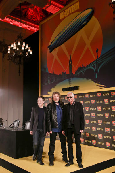Bassist and keyboardist John Paul Jones, from left, frontman Robert Plant and guitarist Jimmy Page pose for photos at a media screening ahead of the worldwide theatrical release of Led Zeppelin's 2007 Celebration Day concert at the O2, on Friday, Sept. 21, 2012 in London. (Photo by Miles Willis/Invision/AP)