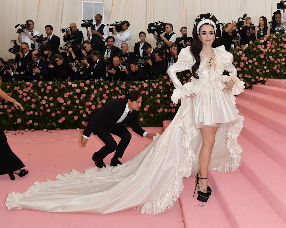 """<h1 class=""""title"""">Lily Collins in Giambattista Valli Haute Couture wearing Cartier jewelry</h1><cite class=""""credit"""">Photo: Getty Images</cite>"""