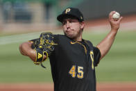 Pittsburgh Pirates starter Derek Holland pitches against the Detroit Tigers in the first inning of a baseball game, Saturday, Aug. 8, 2020, in Pittsburgh. (AP Photo/Keith Srakocic)