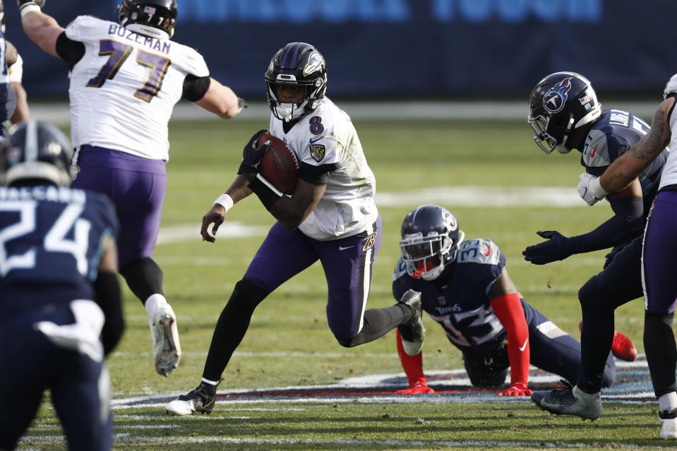 Baltimore Ravens quarterback Lamar Jackson (8) scrambles against the Tennessee Titans in the second half of an NFL wild-card playoff football game Sunday, Jan. 10, 2021, in Nashville, Tenn. (AP Photo/Wade Payne)