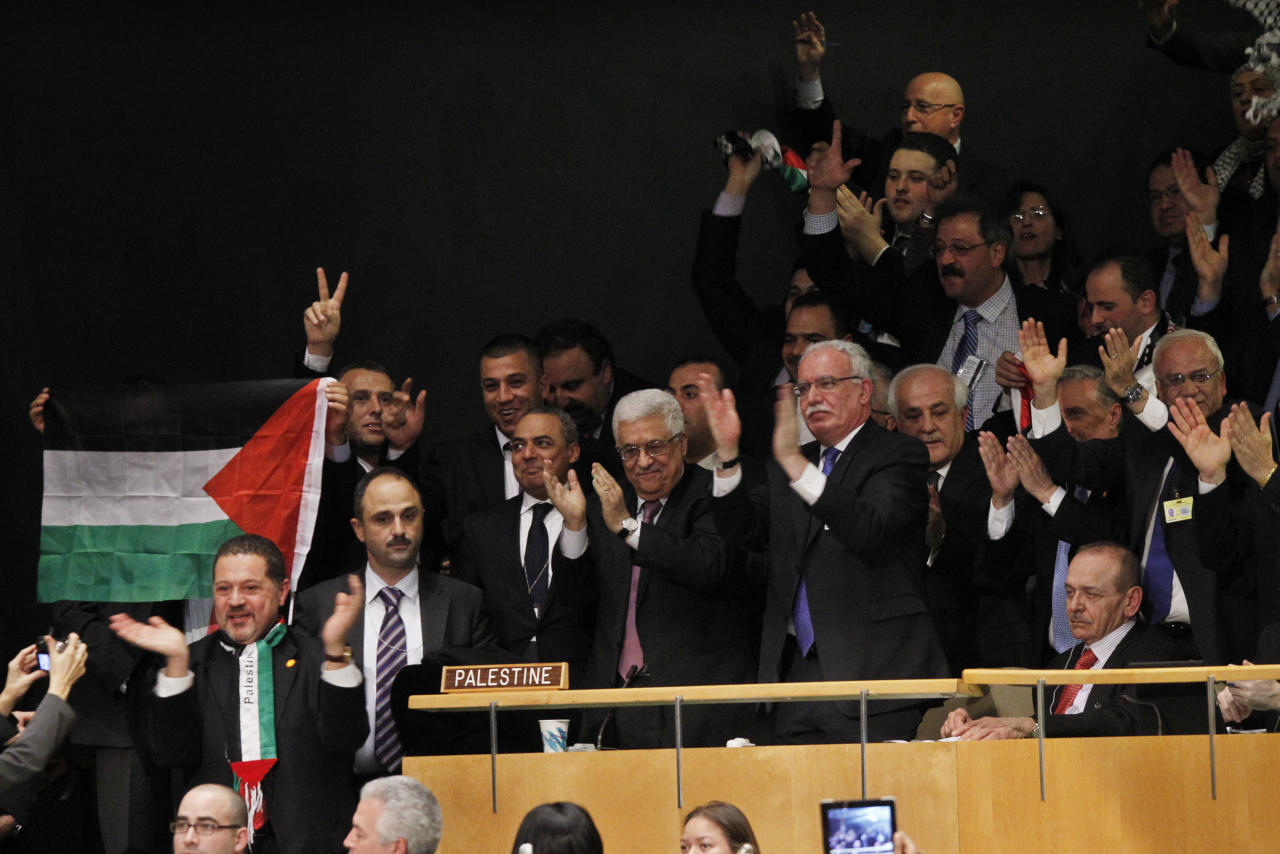 IMAGE DISTRIBUTED FOR AVAAZ - President of the Palestinan National Authority Mahmoud Abbas, center, celebrates with members of his delegation and other supporters after the U.N. General Assembly's historic vote to recognize Palestine as its 194th State at U.N. Headquarters, Thursday, Nov. 29, 2012. (Jason DeCrow/AP Images for Avaaz)
