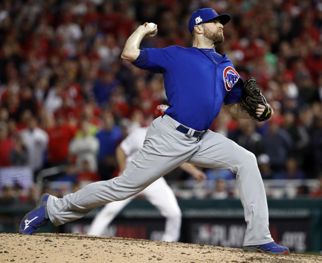 "<a class=""link rapid-noclick-resp"" href=""/mlb/players/8174/"" data-ylk=""slk:Wade Davis"">Wade Davis</a> enters free agency after saving 32 games for the Cubs last season. (AP)"