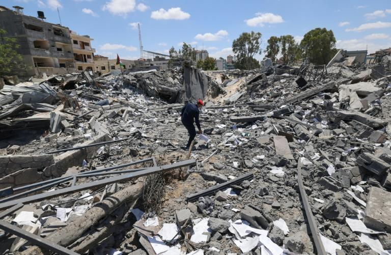 A Palestinian policeman walks on the rubble of Gaza's police headquarters in Gaza City on May 22