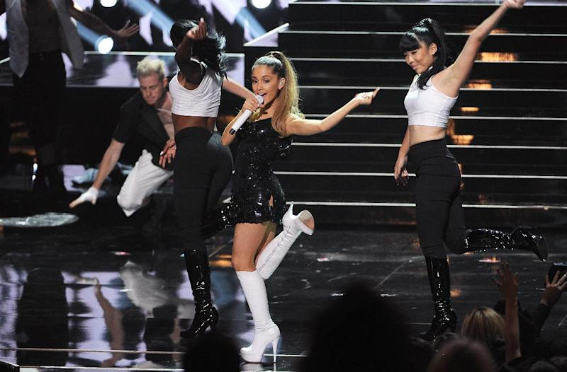 "FILE - In this May 1, 2014 file photo, Ariana Grande performs at the iHeartRadio Music Awards at the Shrine Auditorium in Los Angeles. Grande is having a breakthrough in music with the multiplatinum hit ""Problem,"" which is spending its 13th week in the top 10 on the Billboard Hot 100 chart. The song features rapper Iggy Azalea and is from Grande's sophomore album, ""My Everything,"" to be released Aug. 25, 2014. (Photo by Chris Pizzello/Invision/AP, file)"
