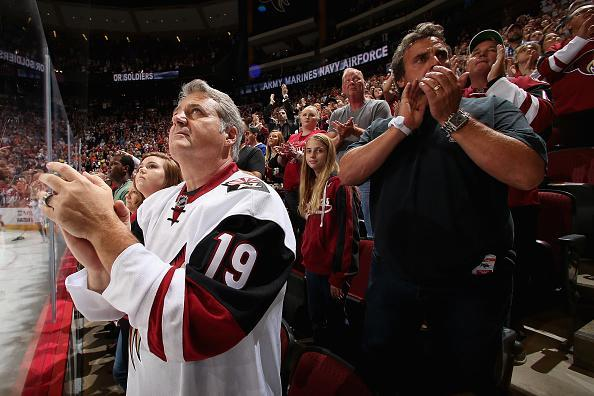 "Fans cheer during the NHL game between the <a class=""link rapid-noclick-resp"" href=""/nhl/teams/ari/"" data-ylk=""slk:Arizona Coyotes"">Arizona Coyotes</a> and the Philadelphia Flyers at Gila River Arena on October 15, 2016 in Glendale, Arizona. The Coyotes defeated the Flyers 4-3 in overtime. (Getty Images)"