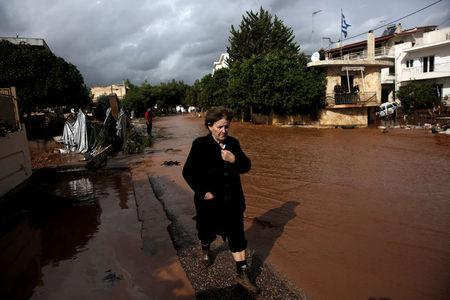 A local walks next to a flooded street following a heavy rainfall in the town of Mandra, Greece, November 15, 2017. REUTERS/Alkis Konstantinidis