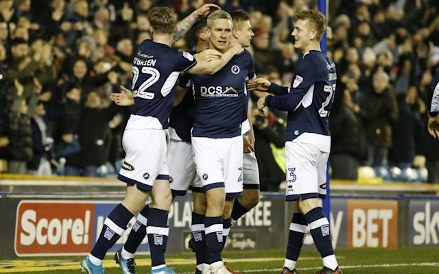"In the summer of 2015 two former Millwall team-mates met up at the Aquashow Water Park in the Algarve. As their families played in the sunshine Steve Morison and Neil Harris slipped away for a quiet beer and a chat about what had happened to their beloved club. Millwall had just been relegated to League One and the place was, according to Morison, ""a shambles"". If there was hope it existed solely in Harris - Millwall's record scorer and a true club legend - having just accepted the daunting post of manager. Harris had a plan, and central to it was a new centre-forward and dressing room leader - and he wanted Morison to fill both those roles. ""I remember rejoining Millwall that summer, walking through the door and the club was just back,"" remembers Morison. ""It was different suddenly. We were back to where we needed to be. Now we are reaping our rewards."" And those rewards could, to wide-spread astonishment, include promotion to the Premier League. Millwall go into Friday night's game with Fulham on the back of a 17-game unbeaten run that has taken them from 19th to sixth in the Championship, with the final play-off spot in their hands. Despite having one of the smallest budgets and average gates in the division, no star players, and the lingering threat of losing their stadium, Millwall are in with a shot at the big time. ""This is a free shot at promotion for us, 100 per cent"" says Morison. ""If other teams don't make it their manager will lose their job. They'll release their players or sell them because they're not good enough and spend £20million-£30m to try and do it next year. That's where the pressure is - it ain't on us. Steve Morison and Neil Harris celebrate promotion through the play-offs Credit: Getty images ""If we make the play-offs we'd think: 'We might as well go to Wembley now'. And if we do that we'd be in the huddle before the game and I'll say: 'Shall we go Prem?' We just want to see how far we can take this rollercoaster."" But the question everyone is asking is quite how Millwall got here in the first place, having only been promoted after sneaking into the League One play-offs on the final day of last season. ""How has this happened? Hard work,"" Morison says. ""We run further than the other teams. We want it more than other teams. We've found our way of playing and I think lots of teams look at it and go - 'We're playing Millwall today, we'll beat them as we're better than them and get paid more than them'. ""They turn up, we give them a whack after 10 minutes and they're moaning because you shouldn't be able to do that to them, it's not in the script. ""Then we've added a bit of quality and as a team we defend manfully all over the pitch. There's a real sense that if we play to our potential nobody can beat us. In the dressing room the other day someone said 'Fulham will be a tough game on Friday' and someone else came out with 'Nah, they can't beat us'. ""We are an underdog team that work incredibly hard. Apart from Tim Cahill every single player in that dressing room, me included, if we stopped tomorrow we would have to work. This is our work now so we come in, work hard and enjoy being here. ""We play the same team every game and the same way every game, and we just keep having moments. We aren't searching for an ingredient - we keep making the same cake."" That means unapologetically direct football, utter commitment and a rock-solid team spirit, with Harris' background checks on every potential signing paying dividends. No one player is paid significantly more than any other, with Morison's weekly 'Thursday Club' nights out keeping the squad tight-knit. Off the field the club has also won a battle with Lewisham Council over the compulsary purchase of land around the New Den which could have left them homeless. That galvanised the fanbase while Harris worked wonders with the team. Key to that was finding a settled side - he has made just three changes to his starting XI in as many games - as they became the form team in the division with the exception of Friday's opponents, who are on a 21-game unbeaten run of their own. But as expectations start to alter those central to Millwall's success are adamant promotion would not change them. ""If we get there we'll live the dream but this club won't start paying stupid money,"" says Morison. ""I look at teams that go up to the Premier League, pay players a fortune, come down and are still paying them a fortune. I can't believe how many players get paid not to play football. I look at the geezer [Jack] Rodwell up at Sunderland, he gets paid £70,000 a week not to play. Where's their drive, where's their ambition to get to the next level? Morison insists there is no pressure on Millwall Credit: Pa ""This club won't lose its' values or workmanlike class. And Millwall, honestly, it's a nice club. People think it's a horrible place to come and play but it's actually a really nice place to come and play - as long as you're willing to work hard."" Nice is not often a word associated with Millwall and their supporters, though. There is every chance Millwall may soon be ready for the Premier League, but will the Premier League be ready for Millwall? ""I don't think the police will be,"" laughs Morison. ""Look, we get hardly any tickets away from home now. We went to Sheffield United and got 1200 tickets. Preston went there the weekend after and got 2500. It's crazy. ""I think it speaks volumes that no one wants us to get there, apart from people within the football club and our immediate supporters. The other day Sky didn't even put us in their promotion graphic. People aren't paying attention to us, aren't giving us that respect. I don't know who does the voting for Manager of the Season, or who gives the player awards out - but they haven't got a scooby."" He shrugs, as relaxed as at the water park three years ago. ""But as the motto says - we're Millwall and we don't care."" They may not, but soon the Premier League might."