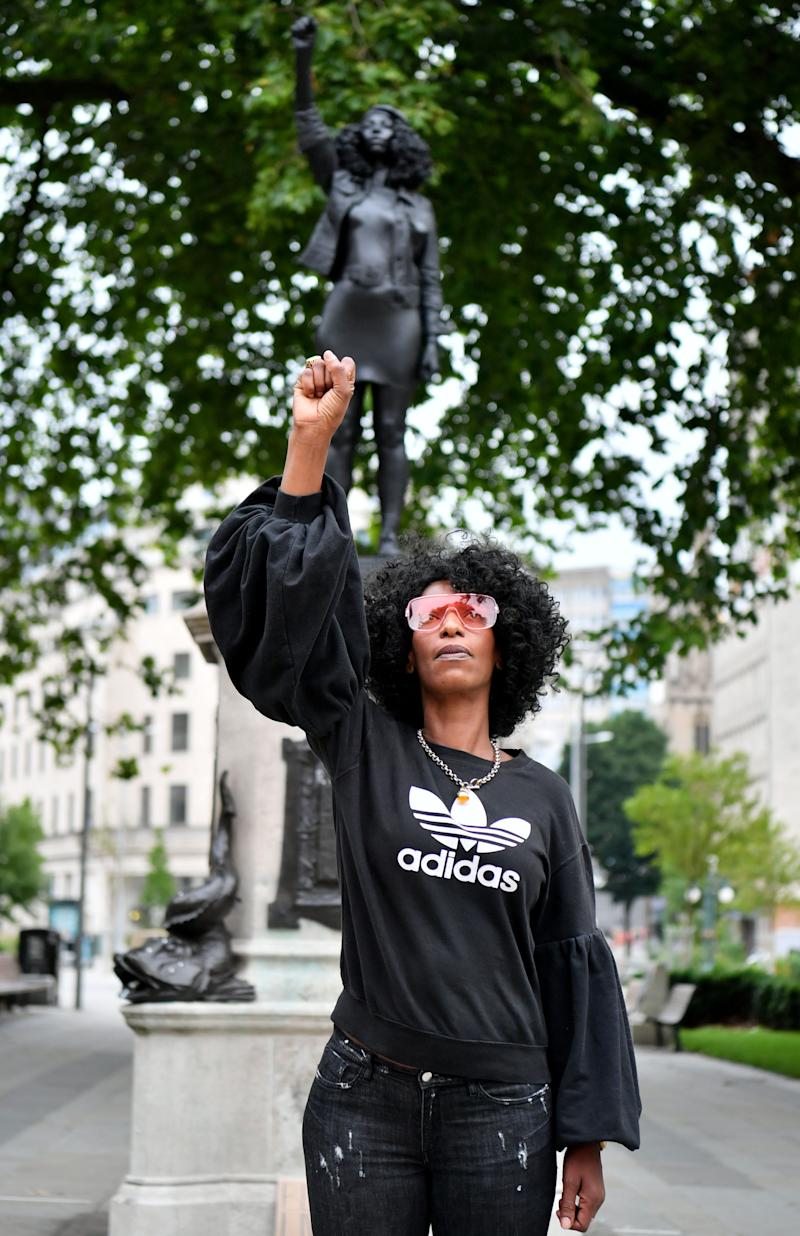 Black Lives Matter protester Jen Reid poses for a photograph in front of a sculpture of herself by artist Marc Quinn in Bristol, England, on July 15.
