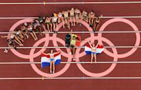 Gold medallist Belgium's Nafissatou Thiam lies at the centre of the exhausted heptathlon field
