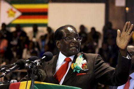 Zimbabwe's President Robert Mugabe gestures while addressing a meeting of veterans of the country's independence war in the capital Harare