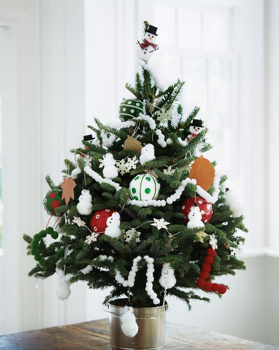 <p>If this year's Christmas celebration needs to be a hit with kids, dress up a mini tree with adorable snowman ornaments.</p>