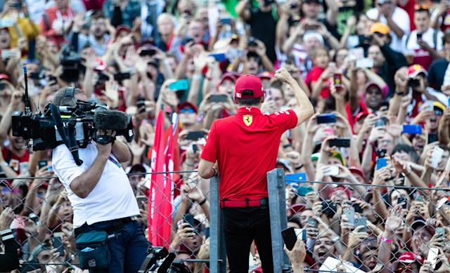 MONZA, ITALY - SEPTEMBER 08: Race winner Charles Leclerc of Monaco and Ferrari celebrates with the fans after the F1 Grand Prix of Italy at Autodromo di Monza on September 08, 2019 in Monza, Italy. (Photo by Lars Baron/Getty Images)