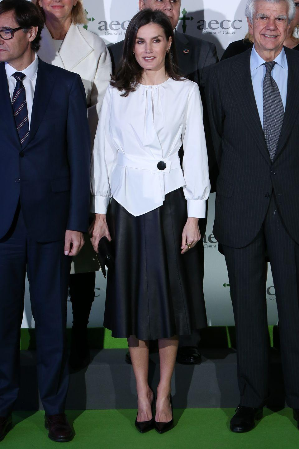 "<p>Queen Letizia wore this black and white outfit to the forum against cancer ( ""El impacto economico y social del cancer en España"") in Madrid. </p>"