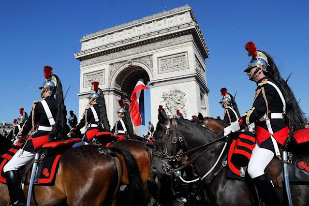 <p>French Republican Guards ride their horse past the Arc de Triomphe in Paris, Friday, July 14, 2017. (Photo: Etienne Laurent, Pool via AP) </p>