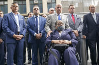 Retired NYPD Detective Barbara Burnette, foreground, who worked on the World Trade Center pile for 23 days after the terrorist attacks in 2001 is joined by her attorney Nicholas Papain, third from right, and former New York Gov. George Pataki, right, and other 9/11 first responders during a news conference, Wednesday, Sept. 8, 2021, in New York. (AP Photo/Mary Altaffer)