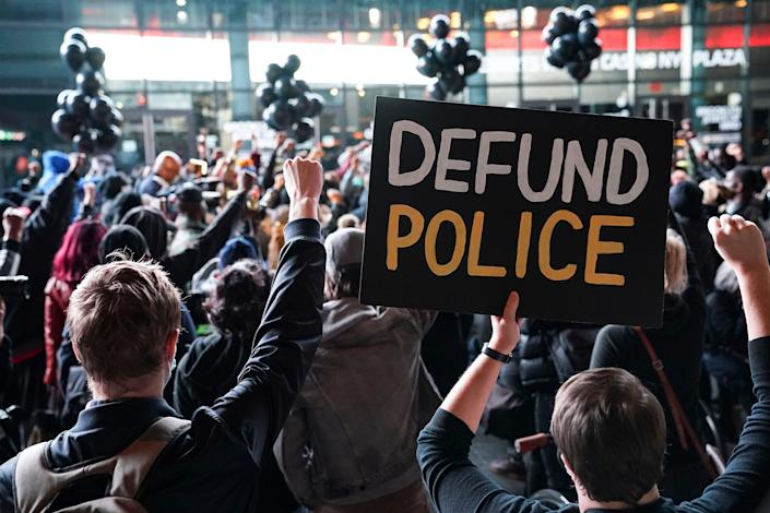 A protester demands the defunding of police during a rally for the late George Floyd outside Barclays Center on Oct. 14, 2020, in New York. Demonstrators gathered on what would have been Floyd's 47th birthday to call for action in correcting systemic racism in policing and criminal justice.