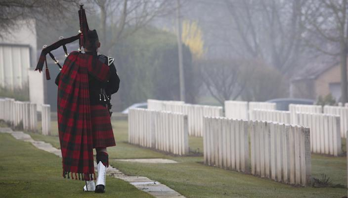 A Scottish Battalion piper plays the lament during the reburial service of British World War One soldier William McAleer at the Loos British World War One cemetery in Loos-en-Gohelle, France on Friday, March 14, 2014. Private William McAleer, of the 7th Battalion, Royal Scots Fusiliers, was killed in action on Sept. 26, 1915 during the Battle of Loos. His body was found and identified in 2010 during routine construction in the area and is being reburied with full military honors. (AP Photo/Virginia Mayo)